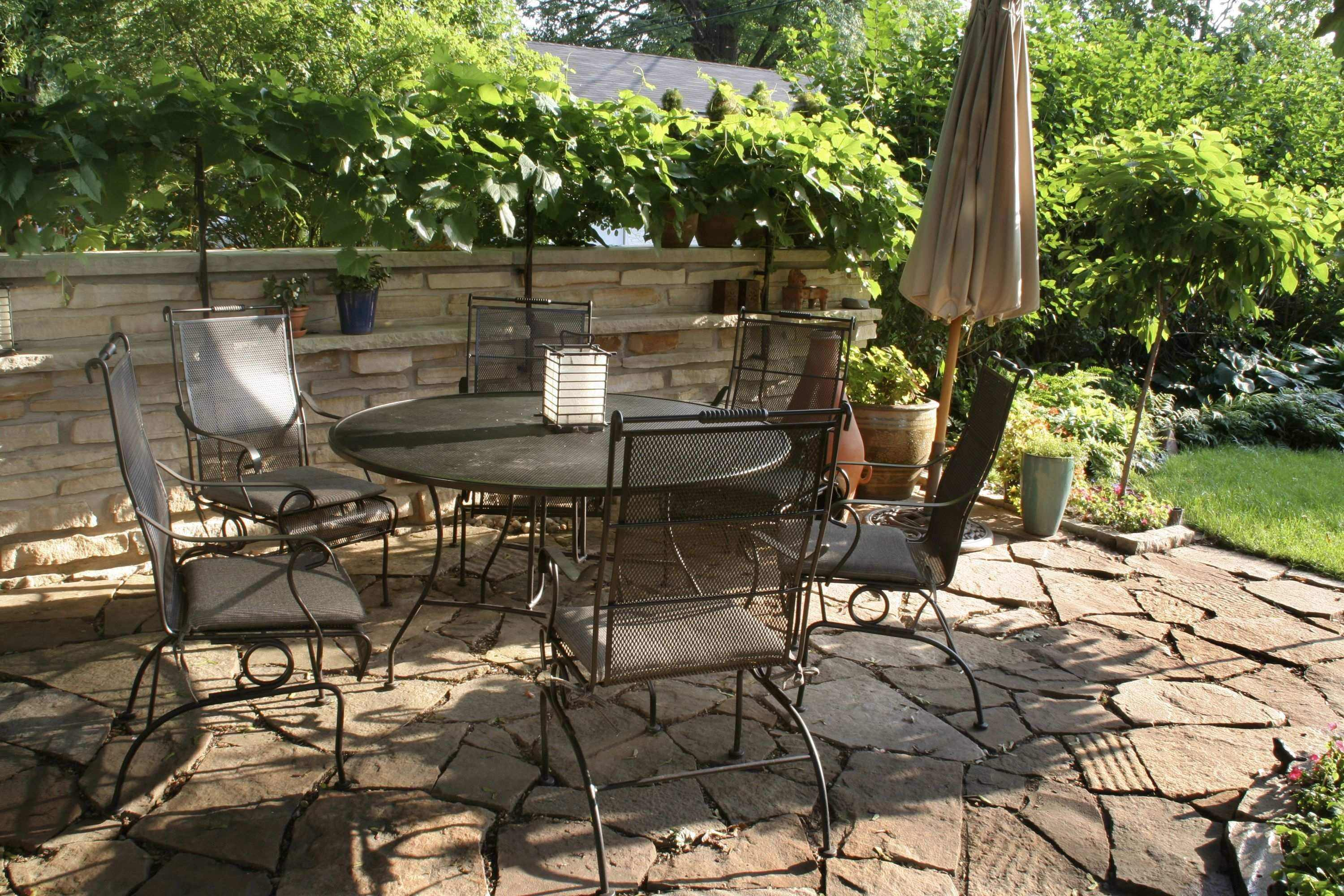 Design your own outdoor dining area garden design for living for Garden patio designs