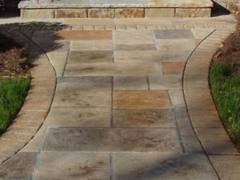 Stamped concrete can be made to look like stone, pavers or brick